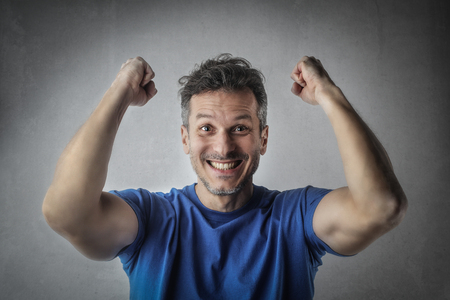 Happy man in blue T-shirt photo