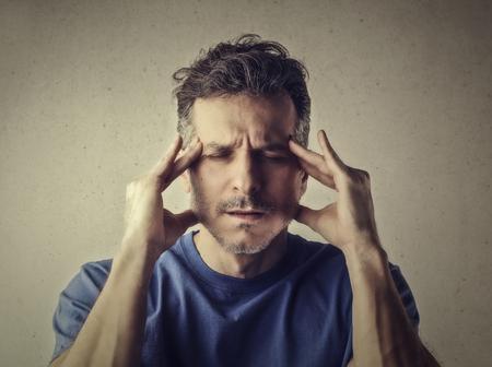 Man has a headache photo