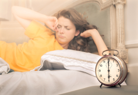 retro woman: Hard wake up in the morning Stock Photo