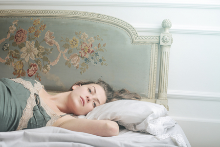 atractive: Relaxing in bed Stock Photo