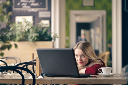 Blonde girl is waiting for an e-mail