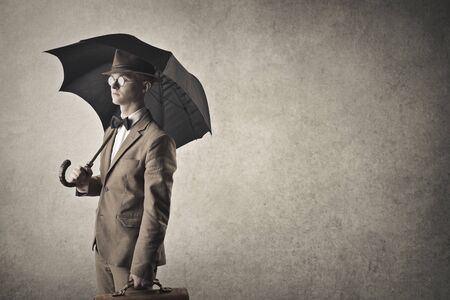 textured backgrounds: Businessman with an umbrella