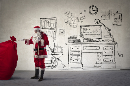 office desk: Santa Claus with a big bag full of gifts