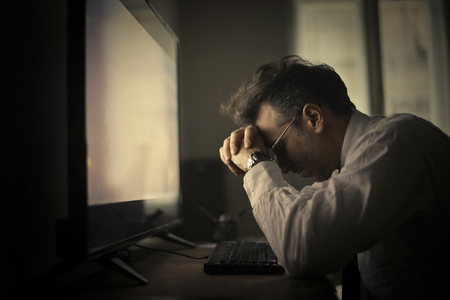 table: Tired man in front of the computer