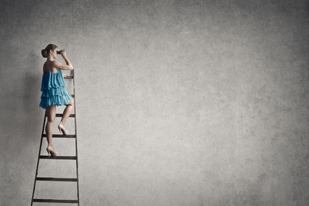 textured backgrounds: Girl in a blue dress on the ladder Stock Photo