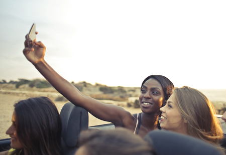 telephone: Beautiful girls are making a selfie in the car