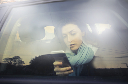 winter fashion: Girl is texting in the car