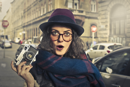 photo: Fashionable girl with a camera Stock Photo