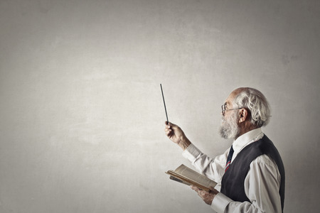 textured backgrounds: Old man is pointing at the wall