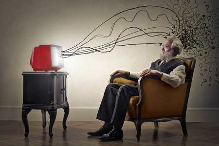 Old Man is watching tv Stock Photo