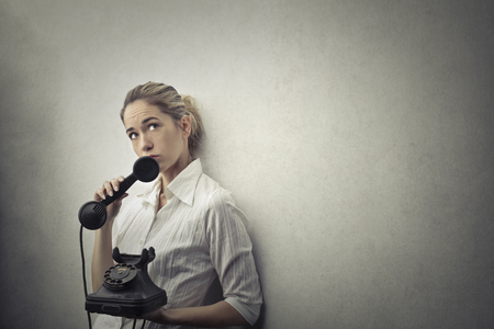 lady on phone: Woman is thinking with the telephone