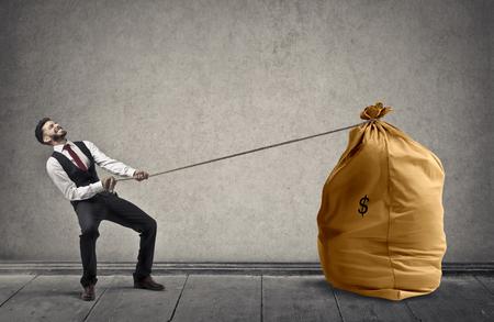 A businessman with a big bag of money Stockfoto