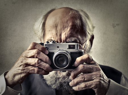 photo: Old man is taking a picture
