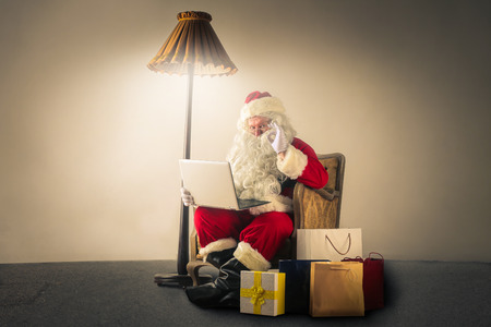 internet search: Santa Claus is shopping online Stock Photo
