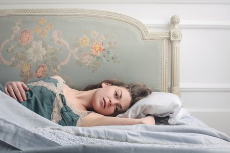 retro woman: Dreaming in bed