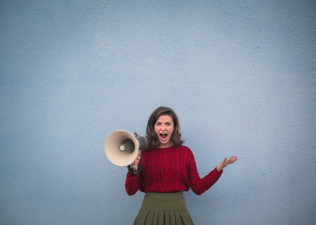 Pretty woman with a megaphone