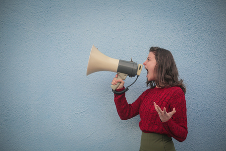 Woman shouting into the megaphone