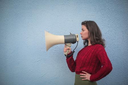 Brunette woman speaking into a megaphone Reklamní fotografie