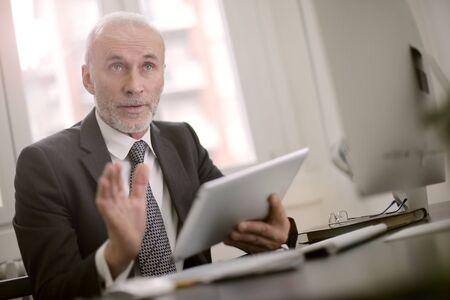 collegue: Businessman has a discussion
