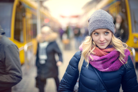 blond girl: Young girl at the tram station Stock Photo