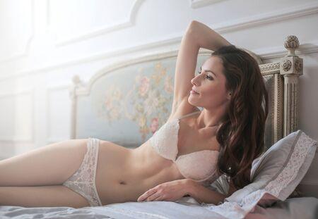 copyspace: Beautiful woman in bed