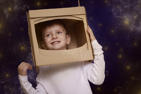 stars: Little boy dressed as an astoranut
