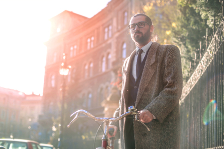 Confident businessman with his bike Stock Photo