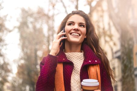 woman on phone: Happy woman has a phone call