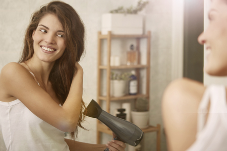 healthy body: Drying hair in the mirror Stock Photo