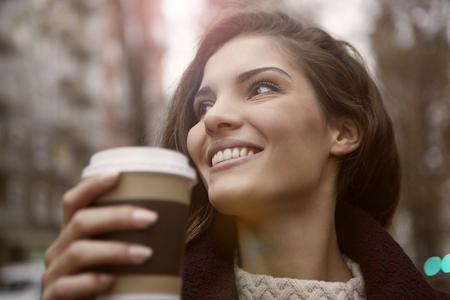 tea hot drink: Smiling woman is drinking coffee Stock Photo
