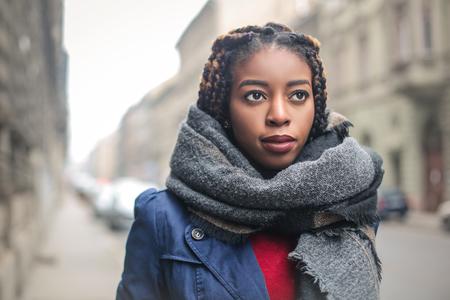 copyspace: Black woman is walking in the street