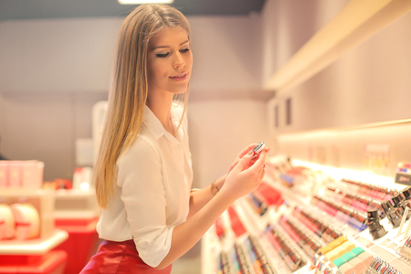 nails: Woman is shopping cosmetics