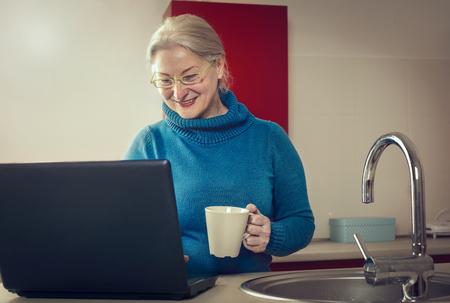 ingedient: Grandma is smiling at her computer