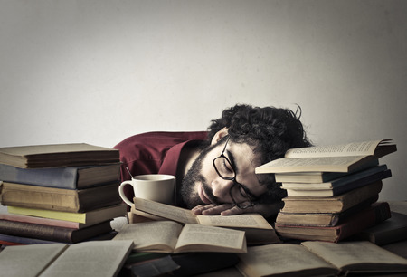 problem: The student is sleeping with his books Stock Photo