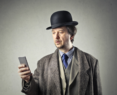 online: Businessman in the six with his phone