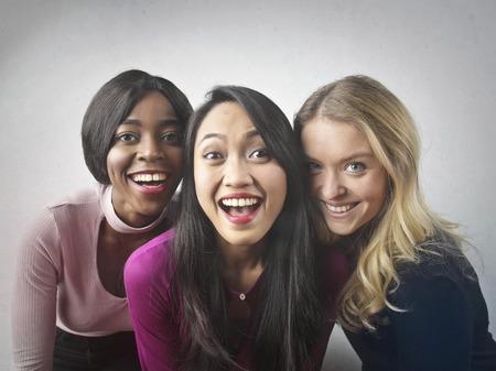 women smiling: Three beautiful women smiling