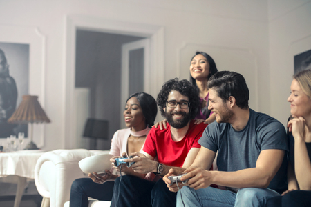 Friends are playing a video game photo