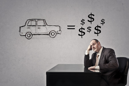 Businessman is thinking about a car and money