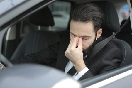 unhappy people: Businessman has a headache