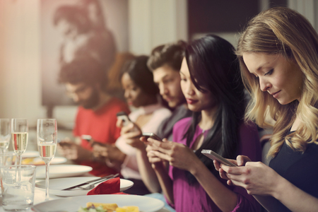 lady on phone: Everybody is texting at the dinner table