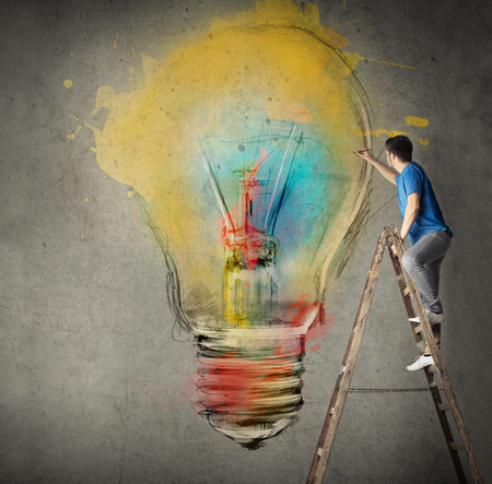 wood texture: Man is painting the colorful bulb on the wall