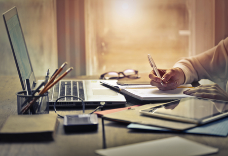 Woman is working hard in the office Standard-Bild