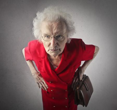 Oude dame is die vervelende Stockfoto