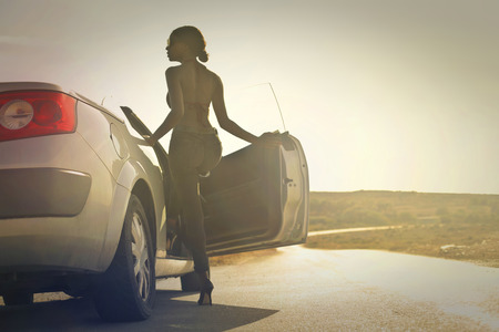 open car door: African girl is going to a trip by car Stock Photo