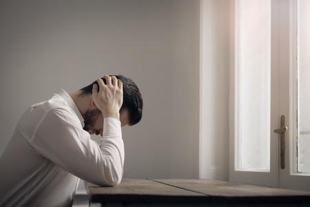 Young man is having a headache