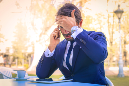 hear business call: The businessman is having some trouble