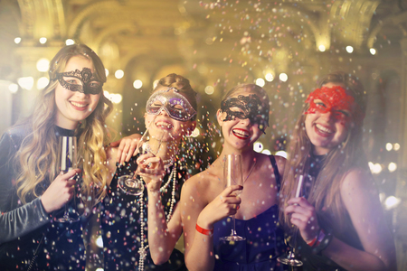 A group of girls are wearing masks and having a party Stock fotó