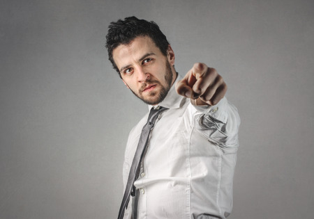 profession: Businessman is pointing at you