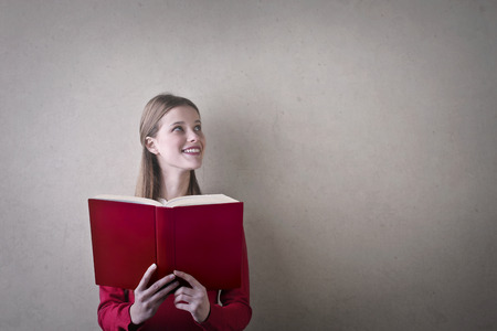 textured: Woman is reading a red book