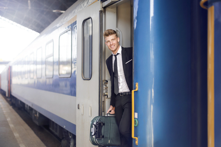 way out: Businessman is traveling with the train Stock Photo